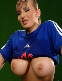 Busty Edo plays football and flashes her tits and pussy