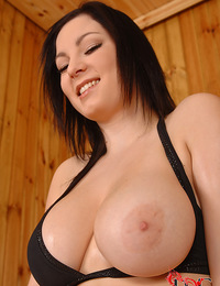 Tempting titties of the curvaceous Nanny in the hot sauna