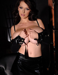 Busty Merilyn shows her F cup tits in a sexy latex outfit
