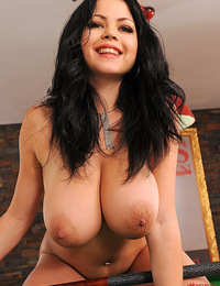Busty Shione Cooper naked on pool table inserting a ball