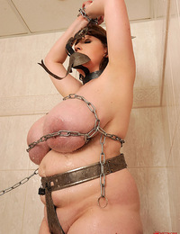 Busty bound babe Eva naked in chains in bathroom exposed