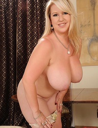 Busty thick babe Janne Hollan presents her big tits for you