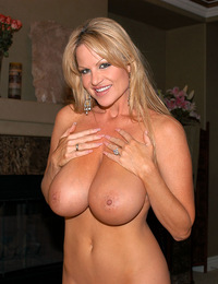 Kelly shows off in black lingerie and ends up covered in white hot jiz.