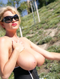 Kelly takes a topless bike ride and rubs lotion all over her tits and gives a handjob.