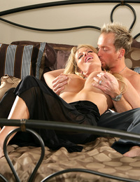 Kelly was in a black see thru nighty, when her husband came in she sat on his cock.