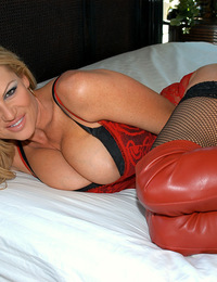 Kelly gets tied up in bed in sexy red lingerie and thigh high red boots.