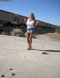 Kelly shows off her super hot tits in the middle of the desert.