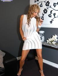 Kelly gives a lap dance in sluty white dress and black bikini.