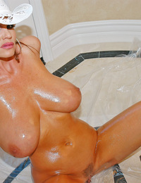 Kelly's big tits are covered in oil!