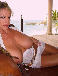 Kelly wears a see thru top and rubs her pussy on the beach.
