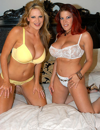 Kelly and her friend play with each others titties.