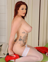 Beautiful buxom redhead Paige in hot latex nurse suit!