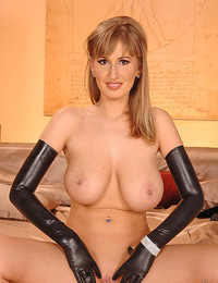 Beautiful busty Edo in and out of a sexy tight latex outfit
